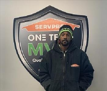 Male SERVPRO employee in front of