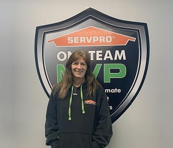 Smiling female SERVPRO employee in front of