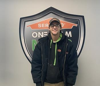 Smiling male SERVPRO employee in front of