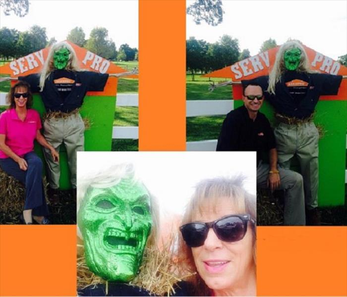 Male and female SERVPRO representatives with SERVPRO scarecrow