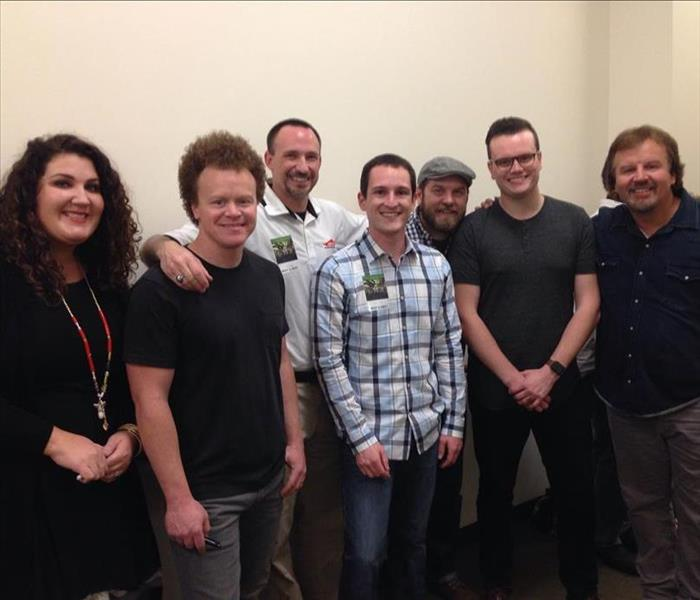 SERVPRO representative with the members of the band Casting Crowns