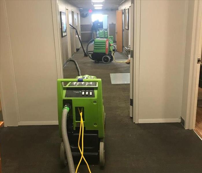 SERVPRO Techcians addressing a recent water damage caused by winter weather in Kankakee County